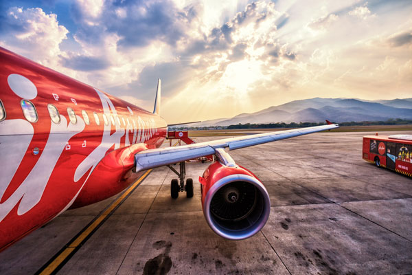AirAsia revenues up but profits hit by rising fuel costs